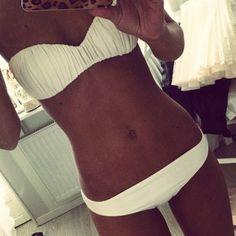 Love this suit! Perfect white for a honeymoon bikini :)
