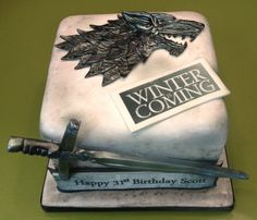 2015 Game of Thrones Season 5 cake with House Stark wolf and sword for birthday party - winter is coming - I'm eager to know how to make Game of Thrones Season 5 cake ! by gameofthrones Game Of Thrones Kuchen, Game Of Thrones Cake, Fancy Cakes, Cute Cakes, Game Of Thrones Birthday Cake, Beautiful Cakes, Amazing Cakes, Game Of Thrones Instagram, Got Party