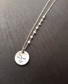 "A darling Sleepy Moon pendant handcrafted in fine silver(.999%) and hangs at 16 1/4"" on sterling silver chain with 7 dainty moonstones wire wrapped to one side. ($42) Only one available.#moonpendant #modernjewelry #moonjewelry"