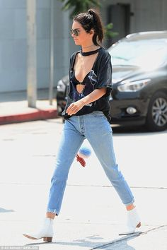 Moon walk:She completed her attire with ankle skimming mom jeans and a pair of white boots