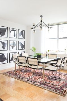 """""""I found an image on Pinterest a long time ago of a large wall filled with geometric shapes in black and white. I simply created some shapes and had them printed 20""""x20"""" and framed them cheaply myself. I think it adds so much drama and height to the dining room and was so easy and inexpensive to complete."""""""