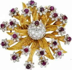 Ruby, Diamond, Gold Brooch, E. Pearl The brooch, designed as a flower, features round-cut rubies weighing a total of approximately 5.00 carats, enhanced by full and single-cut diamonds weighing a total of approximately 4.00 carats, set in 18k yellow gold with rhodium finished accents, completed by a pinstem and catch on the reverse. Marked E. Pearl. Gross weight 47.90 grams. Dimensions: 2 inches x 2 inches