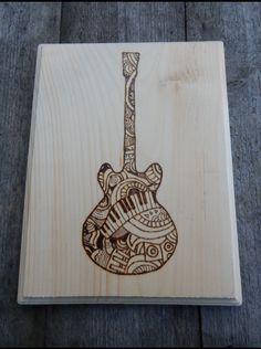 Wood burned guitar- musical pattern