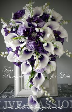 Purple Cascade wedding bouquet featuring purple centred Picasso calla lily, purple roses, African violet flowers, lily of the valley, pastel lilac and white roses - a stunning bridal tear bouquet of artificial flowers created for bride to be Lois Lily Bouquet Wedding, Cascading Wedding Bouquets, Calla Lily Bouquet, Purple Bouquets, Purple Wedding Flowers, Bride Bouquets, Bridal Flowers, Flower Bouquets, Cascade Bouquet