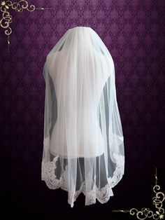 Product Info Veils Colors    Beautiful fingertip wedding veil made with soft tulle and French Alecon Lace at the hem. Gathered with comb at the top for easy wear.   Length: approx 35 inches