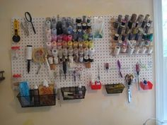 Sewing organization.  Peg board for thread and other items that need to be readily available.