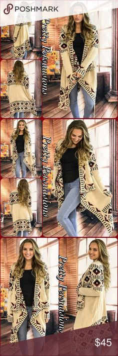 """Cascading Open Front Tribal Heavy Knit Cardigan NWT Cascading Open Front Tribal Heavy Knit Cardigan  Available in S, M, L Measurements taken from a small  Length: 35"""" Bust: 40""""    Waist: 40""""  100% Acrylic   Features  • long, draped cascading open front • tribal boho design throughout  • long sleeves  • thick cozy material   Bundle discounts available  No pp or trades   Item # 1/1010110450TCS boho tribal aztec draped long cardigan fall winter Pretty Persuasions Sweaters Cardigans"""