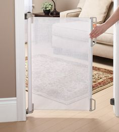 The perfect baby gate for us....can pull it out when I have little ones over, and push it back in when I don't!