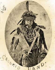 "Despite a palsied hand, Crooked Hand, a Pawnee, gained notoriety as the ""greatest warrior in the tribe,"" anthropologist George Bird Grinnell reported. His son, Dog Chief, went on to serve as a U.S. Indian scout in the 1870s. This photo of Crooked Hand was taken circa 1870, three years before the warrior died.  – Courtesy Smithsonian Institution Bureau of American Ethnology –"