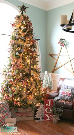 A Country Plaid and Burlap Christmas Tree with burlap, plaid and buffalo check! | All the details at TheTurquoiseHome.com