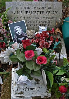 Close up shot of the grave of Jack the Ripper's final victim, Marie Jeanette Kelly. She was the youngest of the five victims and it was said she was the most attractive. Murdered in her small room in Miller's Court on Dorset Street 9 November 1888. The small picture on the left is an artist's rendition of what Mary may have looked like.