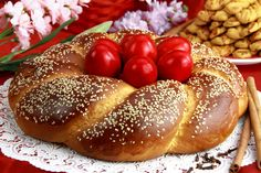 Photo about A traditional sweet brioche bread, called tsoureki, decorated with red eggs (Greek recipe). Image of cinnamon, easter, mediterranean - 19212213 Italian Easter Bread, Greek Sweets, Greek Easter, Brioche Bread, Easter Celebration, Easter Recipes, Easter Food, Greek Recipes, Sweet Bread