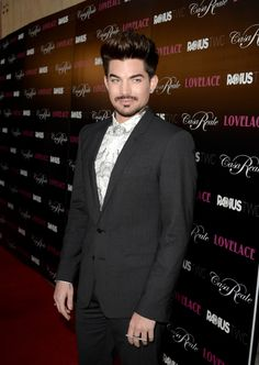 Adam Lambert poses for our entertainment on the red carpet at the premiere of Lovelace on Aug. 5 in Hollywood, Calif.�