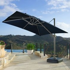 Portofino 10 foot Resort Umbrella in Navy Blue - the full motion articulating umbrella is a state of the art structure!