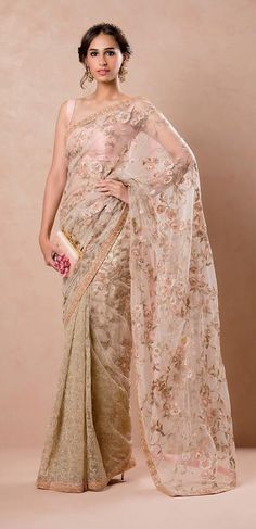 A Sublime Tulle Saree encrusted with winding Florals and edged with a Zardosi border by Shyamal and Bhumika #sublimetulle #florals #zardosiborder #shyamalandbhumika