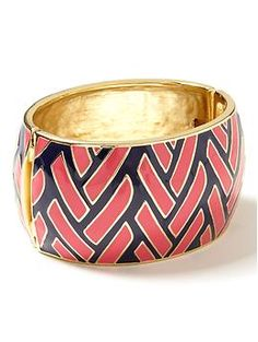 love this cuff.  my wrists are tiny so i probably can't wear this, but it's pretty :-)