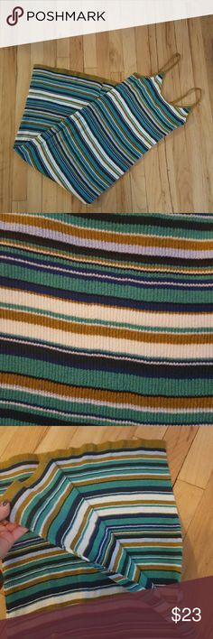 NWT H&M striped dress w/ slit. Size small/medium. NWT H&M striped body con dress w/ slit.  White, gold, blue, green stripes. Spaghetti straps. Ribbed. Hits around the shin. Size small but I think it fits more like a medium. Would be great for small or large chested. Super cute!   Make me an offer! Bundles welcomed! Happy poshing! XO H&M Dresses Midi