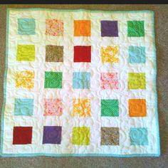 Easy baby quilt. I like the traditional squares w/ white background.