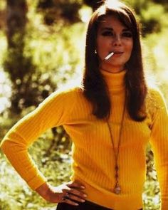 Natalie posing in a #yellow sweater. Part os the Yellow Sweater Series. #smokin