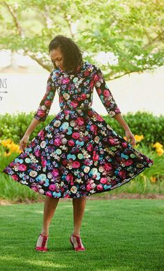 Women's floral print fit and flare 1950 style dress available in black and white