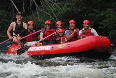 Happy family white water rafting on the Pigeon River