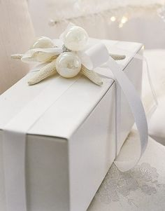 white boxes with white shells and a white ball.)