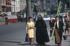 Nun of that: A woman in religious habit walks along O'Connell Street in Dublin with a woman wearing a yellow dress, while a man carries a ladder and another woman holds an umbrella while a man cycles by, in a scene captured in June 1963 Dublin Street, Dublin City, Old Pictures, Old Photos, Irish Free State, Irish Eyes, Dublin Ireland, Cork Ireland, Colour Images