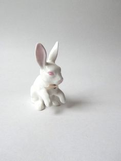 """Wonderful detail on this white bunny with pink eyes and a pink bow. Nice long ears - made of fine china - 3.5"""" tall."""