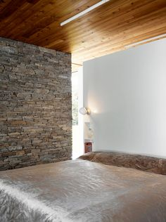 timber ceiling to stone wall.  Love the feeling of earthiness.