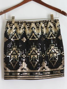 Black and Gold Sequin Aztec Skirt $48 Aztec print embellished sequin skirt! Spandex band for a fit that perfectly hugs your body.