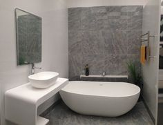 'D' wall hung basin & moulded shelf unit with NERO sit on stonecast basin. Shown with 'D' mirror and NERO stonecast bath