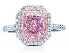 Tiffany and Co purplish-pink diamond ring. Two sparkling rows of pink and white diamonds surround this exquisite 2.20-carat purplish pink diamond. Ring in platinum with a purplish pink diamond and white diamonds.