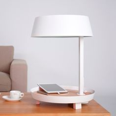 Another lamp, known as the CARRY, with valet tray attached, which includes a rocker switch and USB outlet.