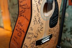 Music was so interwoven into the fabric of this wedding. From their music venue to the guitar picks in the bride's hair, the DIY record luminary centerpieces and the guestbook guitar, this co…