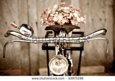 http://image.shutterstock.com/display_pic_with_logo/333667/333667,1327907991,5/stock-photo-old-bicycle-and-flowers-93873286.jpg