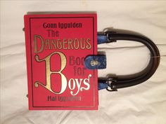 # 35 - book purse # 5 - The Dangerous Book for Boys - what a title!  Found it at Goodwill, for about $1.  The title caught me and the fact that it is on the actual hardcover.  It's big enough for an ipad.  The book itself was a reprint of an early 1900's primer for boys like a Boy Scout handbook.