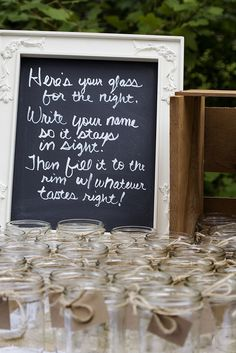 mason jar drinking glasses with names written on them. another idea would be to write everyone's names and table numbers on the tags and use them as the escort cards...