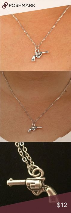 """O1-2 Pistol Necklace Cute silver toned necklace. Chain is about 18"""". New in package. Jewelry Necklaces"""