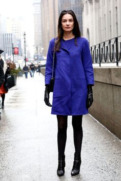 The Best Looks to Hit the Streets at NYFW: Her cobalt hues popped against black tights, booties, and gloves.