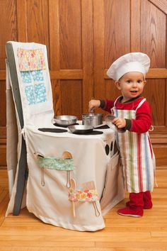 Such a cute little chef with his chair cover play kitchen!  From Joyful Adventures on Etsy