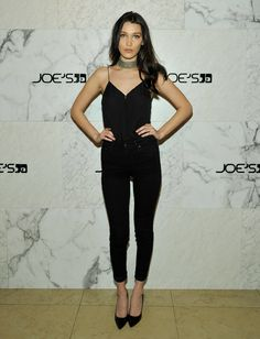 Joe Schmo from Fashion Police Bella Hadid models Joe's Jeans skinnies and a black tank at a celebration in L. for her new campaign with the brand. She still looks great, but the basic black is, dare we say, a tad boring. Look Fashion, Daily Fashion, Fashion Models, Fashion Trends, Fashion Bella, Dress Fashion, Bella Hadid Outfits, Bella Hadid Style, Celebrity Outfits