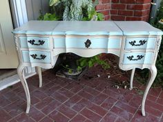 French Vanity Desk Vintage Painted $575 I refinished this lovely piece in a custom mixed bone color. Accented with sea spray - soft pistachio for a rich and romantic feel. Interior of drawers in pink...just because. The neutral, main color has been distressed back to show the rich wood underneath. European hand paint and wax finish - velvet to the touch.