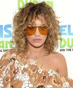 Daily Beauty Buzz: Rita Ora's Curly Shag Rita Ora channeled the with her curly shag hairstyle she wore during a visit to The 'Elvis Duran Morning Show' in New York. Find out why we love her retro style here. Curly Shag Haircut, Trendy Haircut, Curly Hair With Bangs, Haircuts For Curly Hair, Shag Hairstyles, Curly Hair Cuts, Short Curly Hair, Wavy Hair, Curly Hair Styles