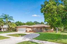Serene water views provide plenty of privacy to this bright & sunny, pool home situated on a navigable canal. Royal Palm Beach, Palm Beach Fl, Palm Beach County, Ranch Exterior, Screened In Patio, Large Backyard, Sliding Glass Door, Large Windows, Luxury Homes