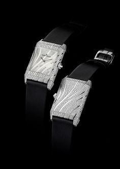 Grande Reverso Neva watch in 18 carat white gold, with a treated fabric bracelet and a Jaeger-LeCoultre Calibre 846/1  A true masterpiece of Jaeger-LeCoultre's fine watchmaking tradition, a blanket of snow-set diamonds covers the casing of the Grande Reverso Neva.