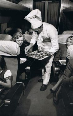 The glory days of air travel. Plane food was made fresh on KLM in 1958, and even hand-delivered by the chef. Is that caviar?
