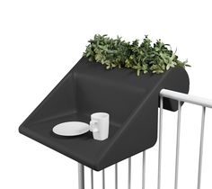 Innovative furnishing concept for small balconies:   The table / shelf-combo with integrated flowerbox is simply hooked onto the balcony railing (up to 60mm tube diameter /width)   balKonzept is perfect for your balcony-party: Just replace the plants by icecubes and some champagne...   Table surface: approx. 600x450mm (Width/ depth)