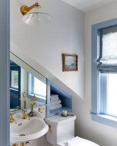 A cornflower blue trim winds through the entire house  for a cohesive look. Not changing the colors between places made...