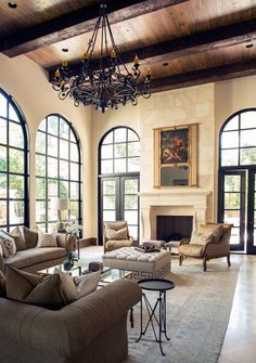 Create a dreamy country-coastal Spanish style home with a light, modern palette and rustic elements such as stone tiles, rounded archways and a timber panelled ceiling. Tuscan House, Home, Spanish Style Home, House Styles, French Country Living Room, Spanish House, Living Room Inspiration, Color Palette Living Room, Stone Fireplace