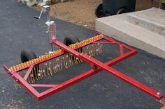 Grass Rake by chief ben -- Homemade grass rake fabricated from steel. Tines were adapted from hay rake springs. http://www.homemadetools.net/homemade-grass-rake